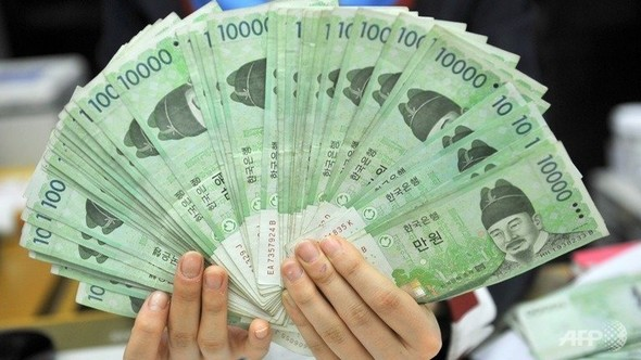 This File Photo Shows A Bank Employee Holding South Korean Won Banknotes At The Korea Exchange In Seoul