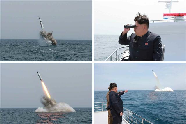 """북한 노동당 기관지는 9일 """"김정은 동지의 직접적인 발기와 세심한 지도 속에 개발 완성된 우리 식의 위력한 전략잠수함 탄도탄 수중 시험 발사가 진행됐다""""며 김정은 노동당 제1비서가 시험 발사를 지켜보는 모습을 담은 사진을 보도했다. 작은 사진은 신문에 함께 공개된 탄도탄의 모습. 붉은색 커다란 글씨로 '북극성-1'이라고 적혀 있다. 한·미 정보당국은 탄도탄을 'KN-11'로 명명한 것으로 알려졌다."""