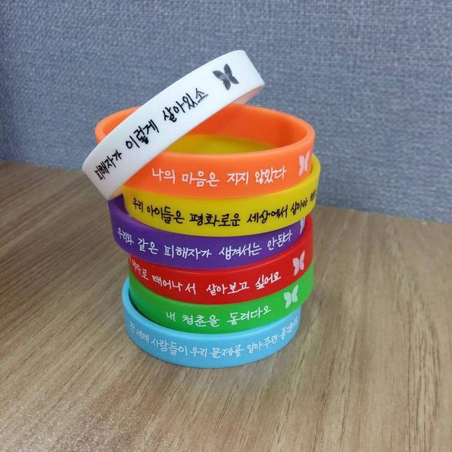 The Group Foundation For Justice Has Made Bracelets In Seven Colors With Messages Expressing Lifelong Wishes And Testimonies Of Former Comfort Women